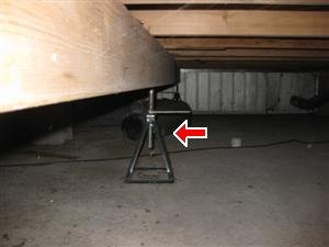 car jack in crawlspace