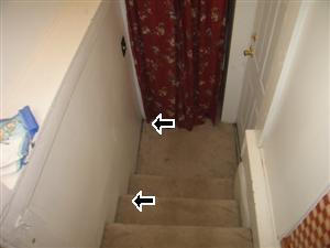 Basement stairs missing railing