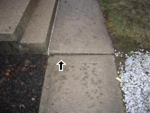 Settled walkway trip hazard