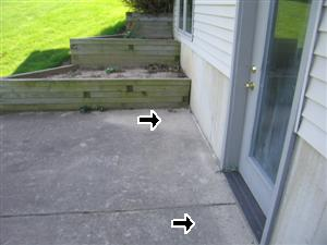 Deck slopes toward house